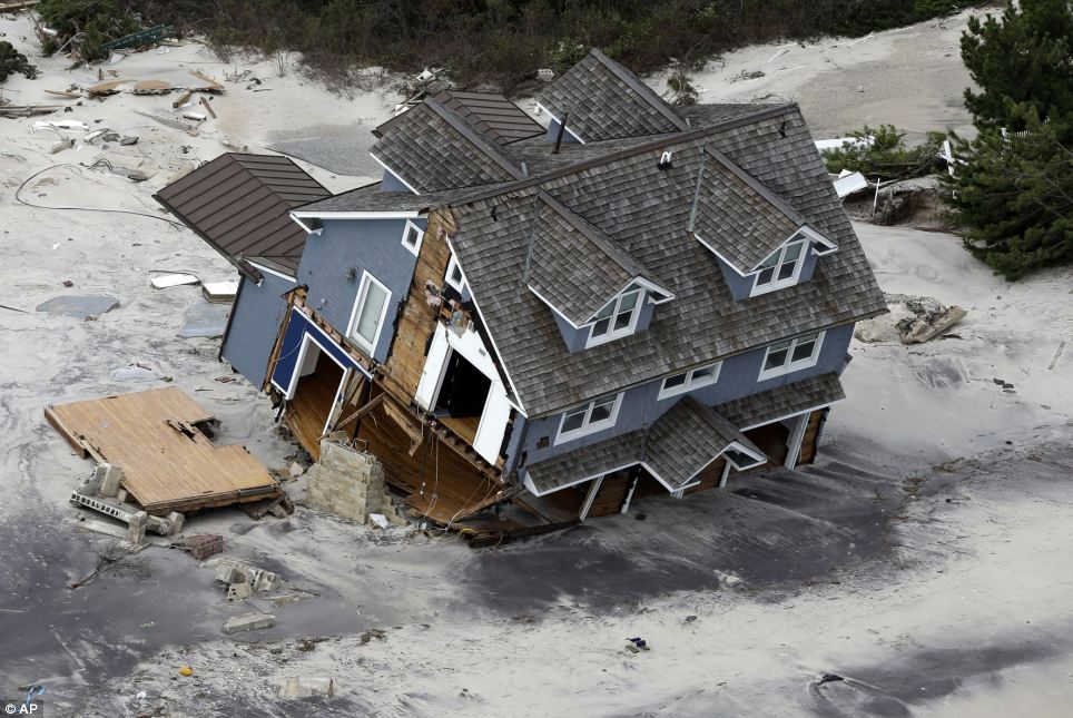 Engulfed: A collapsed house along the central Jersey Shore coast