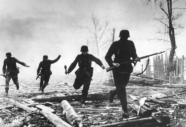 Onslaught: Nazi soldiers rush into action against Red Army positions during the invasion of the Soviet Union in this October 1941