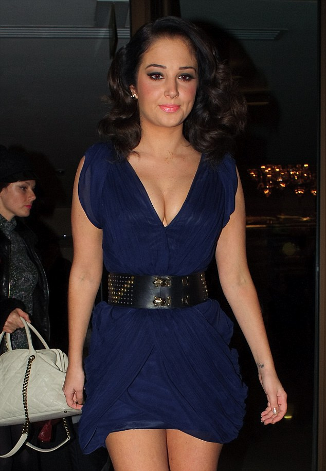 There she goes: Tulisa heads out on Wednesday night to enjoy Halloween in London