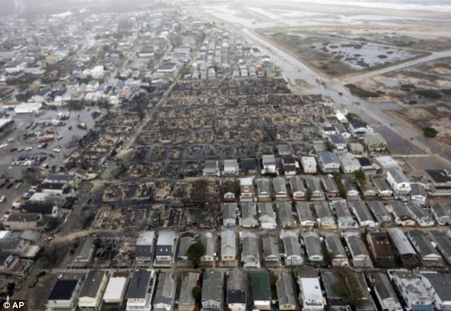 God's retribution? Hurricane Sandy left 111 homes in Breezy Point, Queens, reduced to ash after an uncontrollable blaze spread across the neighbourhood