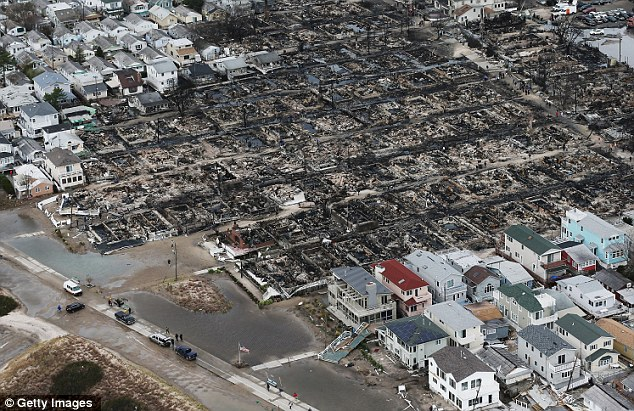 Destruction: The Breezy Point area of New York was devastated by Superstorm Sandy, with flooding and fires wrecking homes and businesses