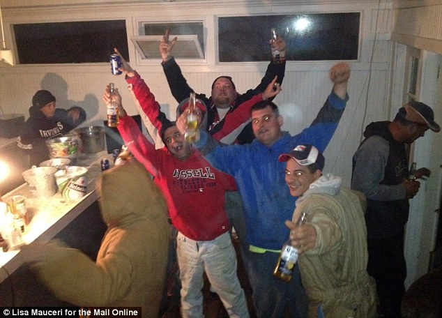 Party time: Residents of Gerritsen Beach, Brooklyn, hooked up a generator and had fun when they found the bar was fully stocked