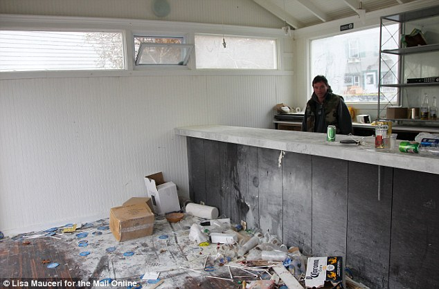 Venue: Gerritsen Beach resident Lawrence Lowey enjoys a beer in the abandoned bar which turned up in the middle of his street