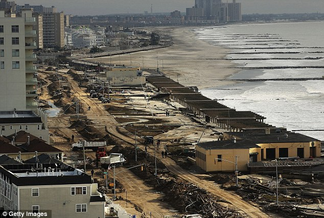 What's left: Mounds of debris can be seen in the massively damaged Rockaway neighborhood
