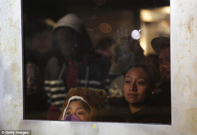 Crossings: Alexandra Lopez, 7, looks out the window of the Staten Island Ferry on November 2