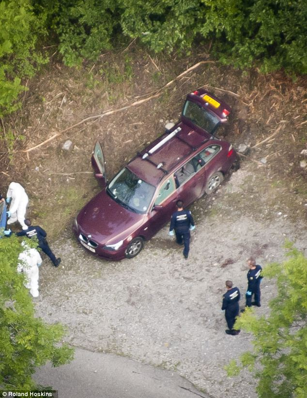 Aerial photo of the car at the murder scene in the forrest near Chevaline and Lake Annecy in the French Alps