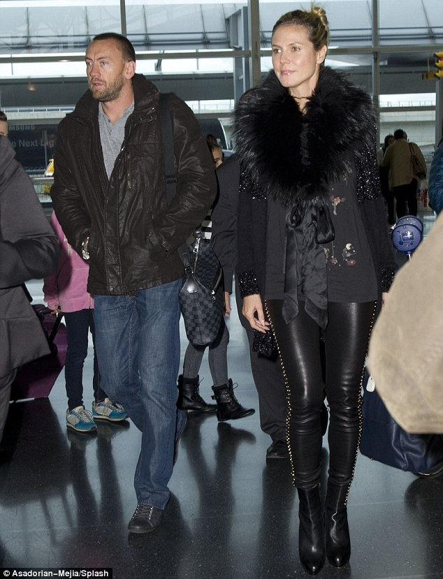 Striking pair: Heidi and Martin were seen strolling through JFK airport on Thursday after jetting in from London