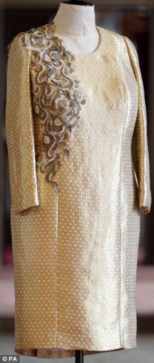 A peek inside ones wardrobe The Queens dresser reveals Her Majs style secrets  Daily Mail