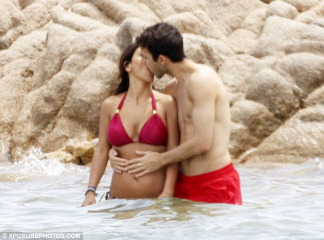 In love: Cesc Fabregas and Daniella Semaan were spotted in an intimate embrace on holiday in Italy earlier this summer