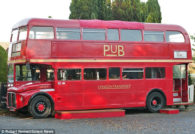 Pub landlord Colin Flitter is turning heads with his double-decker bus - which he's transformed into a mobile English inn