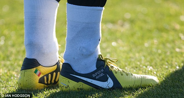 They'll need an angel to get through: Mario Balotelli's personalised boots