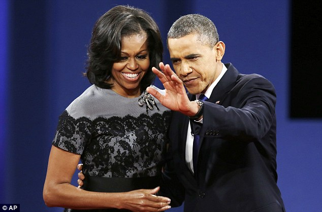 Just the two of us: President Obama appeared with wife Michelle but not Sasha and Malia during the third presidential debate in Florida