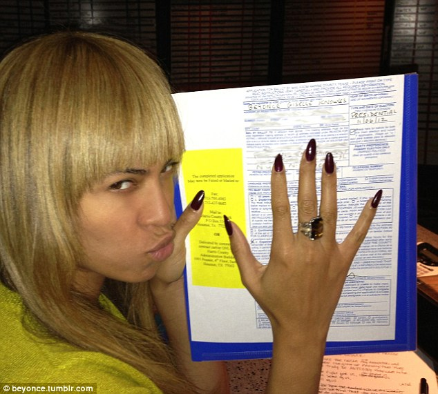 Land of the free: Beyoncé shared a photograph of herself with her voting form filled out and ready to be dropped in the ballot box