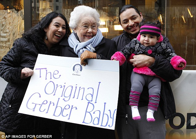 Welcoming a new generation: Little Mary Jane Montoya, who had the winning photo in the Gerber photo contest, poses with her parents, Sara and Billy Montoya, and the original Gerber baby, Ann Turner Cook