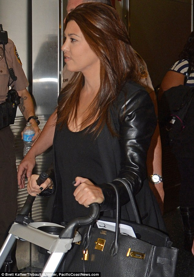 Flawless: Kourtney's hair and make-up was flawless ahead of the flight