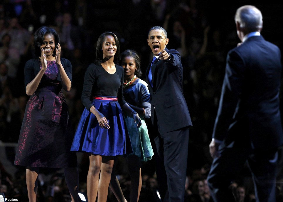 Pleased: The Obama family look on in delight as Vice President Joe Biden walks on stage