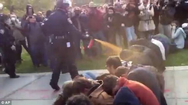 This still, taken from footage recorded on a smartphone, shows students from the University of California, Davis being pepper sprayed as they stage a sit-down protest. A new Apple patent could disable the phone cameras of protesters