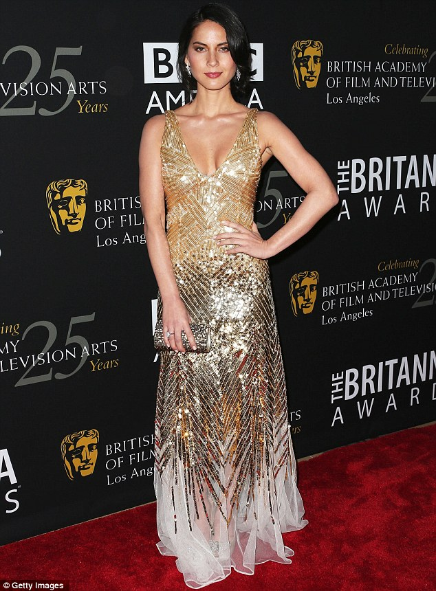 All Goldeneyes were on her: Olivia Munn stole the limelight from Daniel Craig at the BAFTA Britannia Awards in Los Angeles on Wednesday