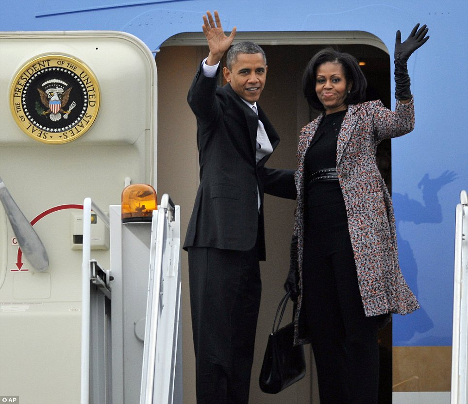 Goodbye Chicago: President Obama and the first lady paused outside Air Force One to wave before heading back to Washington, DC