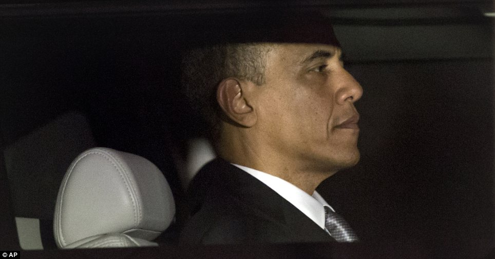 I'm back: Barack Obama as he is driven in to the White House on Wednesday, after being re-elected for another four years as President