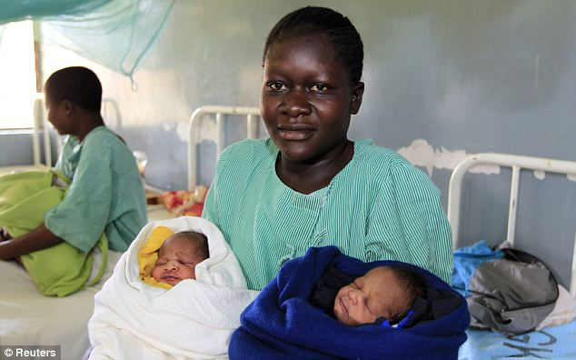 Election enthusiast: Millicent Owuor, 20, holds her newly born twin boys named after U.S. President Barack Obama, left, and Republican presidential candidate Mitt Romney, right.