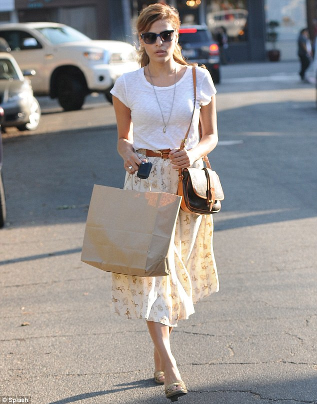 Flowing along: Eva Mendes enjoyed some retail therapy in Los Angeles on Wednesday