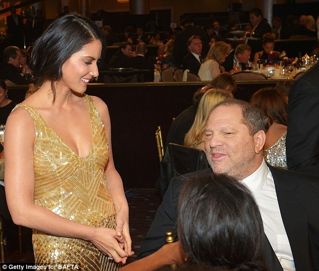He doesn't know where to look: Disciplined Harvey Weinstein managed to resist the temptation to sneak a peek at Olivia's dress