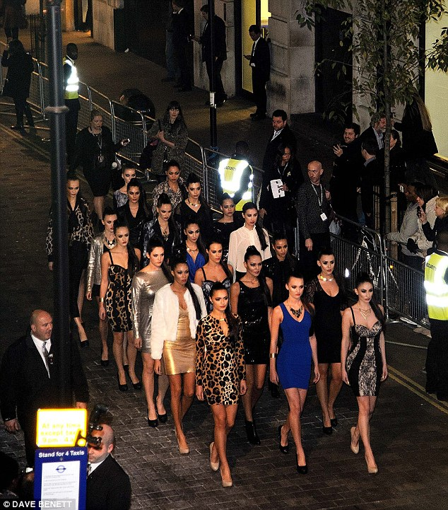 And they're off: The 'Kimbot' models walked in unison out of the venue much to the amusement of bemused onlookers