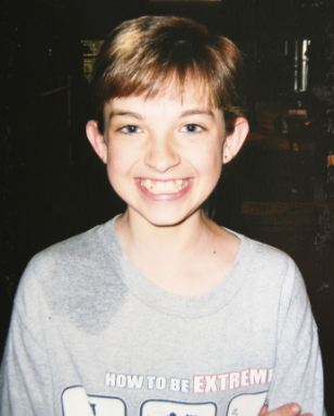 Luke Hill, before he became Katie, aged seven