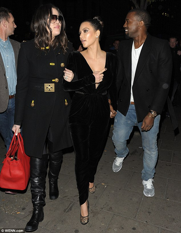 Mayfair lady: Kanye West smiled as he escorted klassy Kim Kardashian and sister Khloe to a restaurant in London on Friday