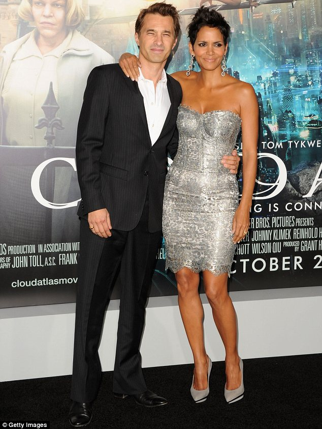 Uprooting: Halle was hoping to move to France with Nahla to live with her Frenchman fiance Olivier Martinez, who she is seen with at the Cloud Atlas premiere on October 24