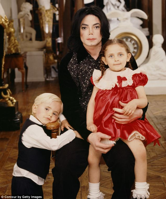 Pride and joy: Michael Jackson, pictured with his two oldest children Prince and Paris in 2001, was used by his family for money, something which continued after his death