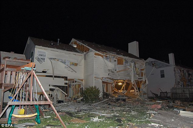 What remains: Approximately 200 people were taken to an elementary school where only about 15 to 25 remained through the night, sleeping on cots