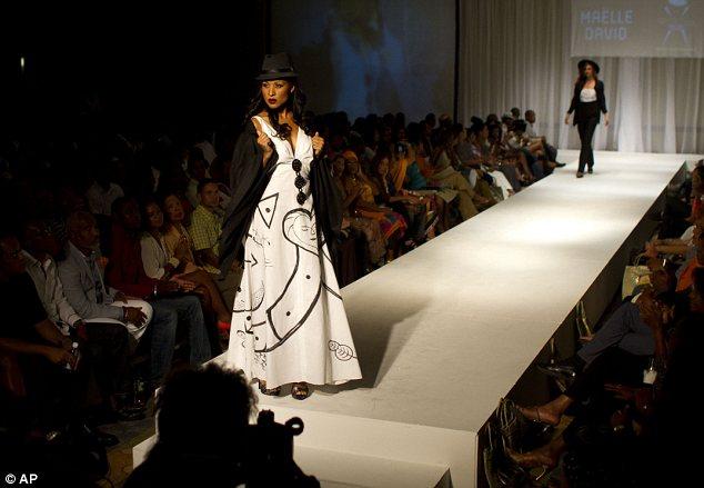A model wears a creation by Haitian designer Maelle David during Fashion Week in Port-au-Prince, Haiti