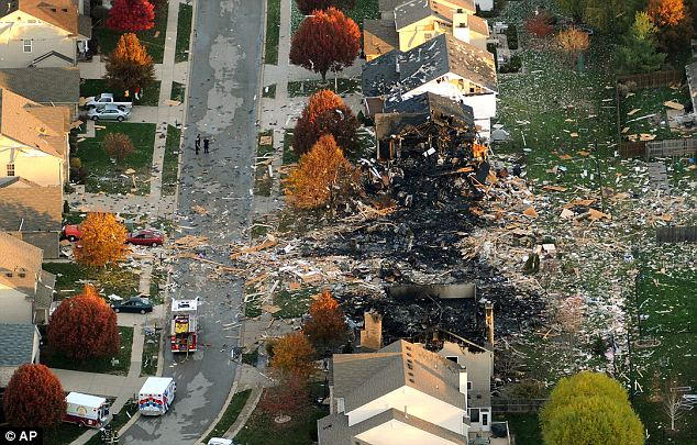 Birds eye: Aerial photo shows two homes that were leveled and numerous neighboring homes that were damaged