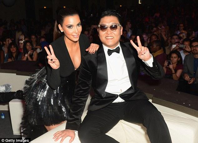 Gangnam style: Kim poses with South Korean pop star Psy