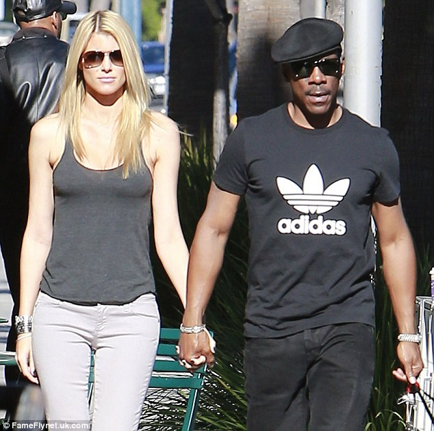 Unconscious flirting: It's clear that Eddie Murphy and his Australian girlfriend, Paige Butcher, are in tune as the lovebirds mirrored each other's body language while grabbing coffee in Beverly Hills Tuesday