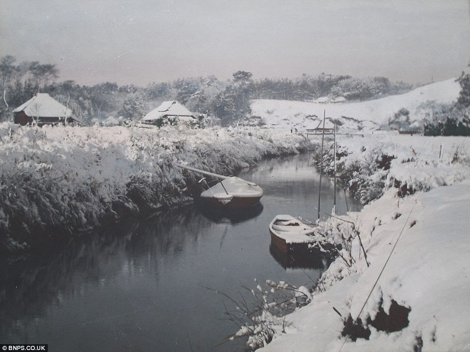 Rural village: The black and white images taken by Kozaburo were painstakingly inked in by a team of 100 colourists