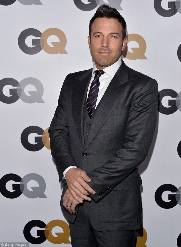 Dapper: Ben Affleck looked handsome in a three-piece charcoal suit