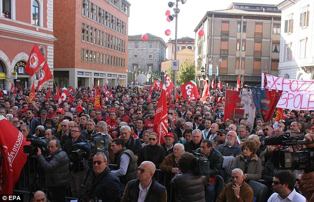 Turnout: A large group of demonstrators file though one of the main streets in the Italian city of Terni