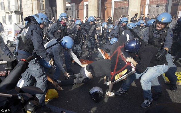 Demonstrators clash with riot police during a protest against Italian Government austerity measures in Rome