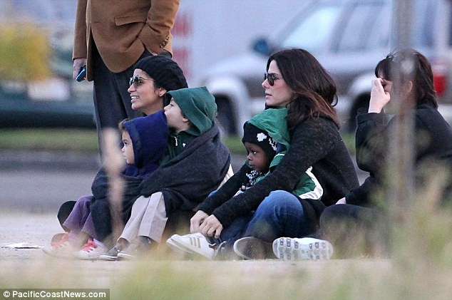 Catching up: Sandra and Camila seem completely at ease with each other as they protect the youngsters from the cold