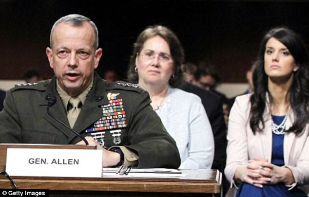 Embroiled: General John Allen - seen here with wife Kathy and daughter Bobbie behind him - is now caught up in thie scandal after being linked with Jill Kelley