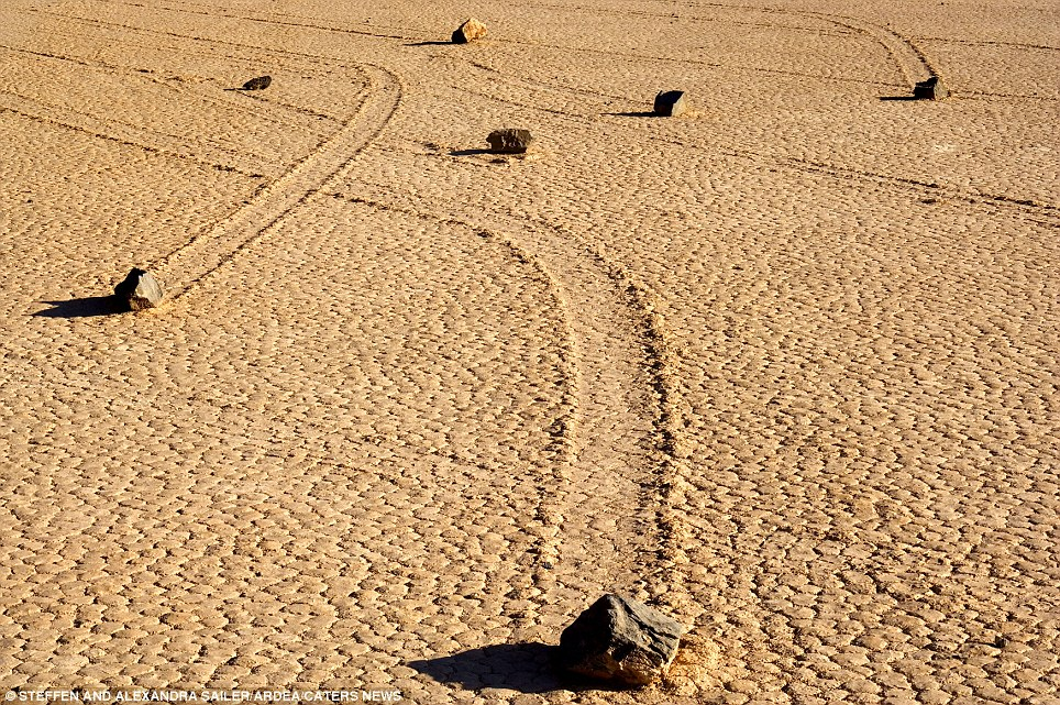 The sliding stones: (Death Valley, California, USA) The movement of the rocks continues to baffle experts who are at a loss to explain why they have moved across a perfectly flat bed despite weighing up to 700 pounds each