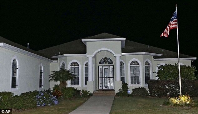 This photo taken Wednesday, Nov. 14, 2012 shows the home owned by FBI agent Frederick Humphries in Dover, Florida