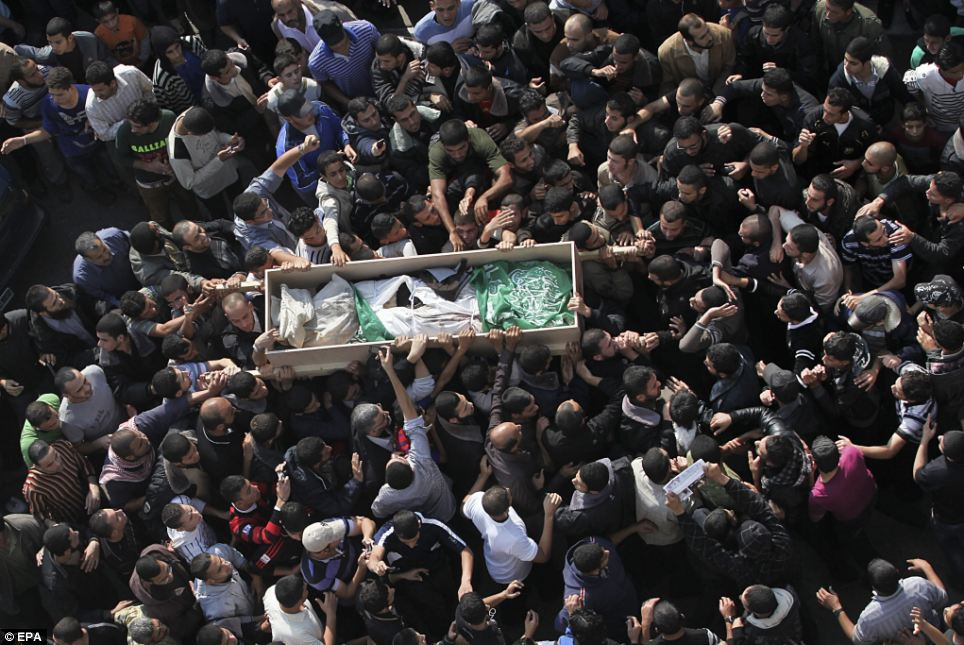Funeral: Thousands of people gathered in the Gaza Strip yesterday for the funeral of Ahmed Ja'abari, the commander of the military wing of the Palestinian Hamas movement