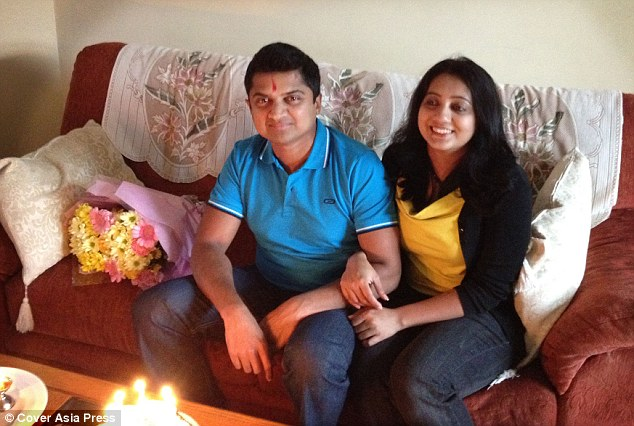 Devastated: Praveen Halappanavar (pictured with his wife Savita at their home in Galway) says he watched helplessly as she died from blood poisoning from a miscarriage after doctors refused to perform an abortion