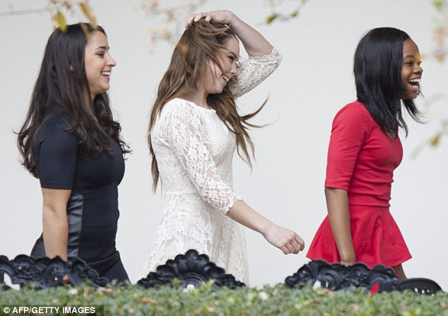 Mini-dress brigade: Jordyn Wieber, McKayla Maroney and Gabby Douglas giggle nervously on their way to the Oval Office