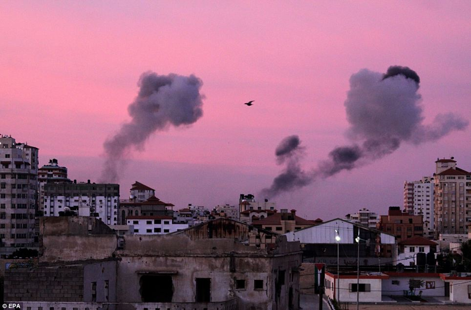 Smoke rises: Missiles continue to be fired by Palestinian militant in the Gaza Strip, as Israel continues to strike targets inside the Gaza Strip in the second day of Operation Pillar Cloud, following the assassination of Hamas militant leader