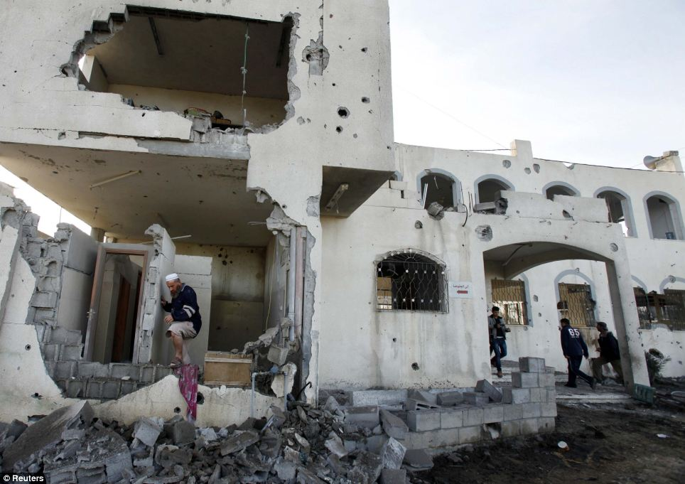 Damage: A Palestinian man inspects a mosque damaged in an Israeli air strike in Beit Hanoun in the northern Gaza Strip